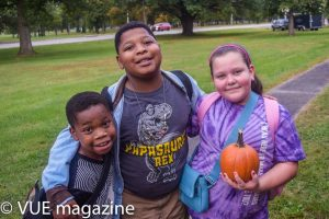 Kids Smiling with a pumpkin